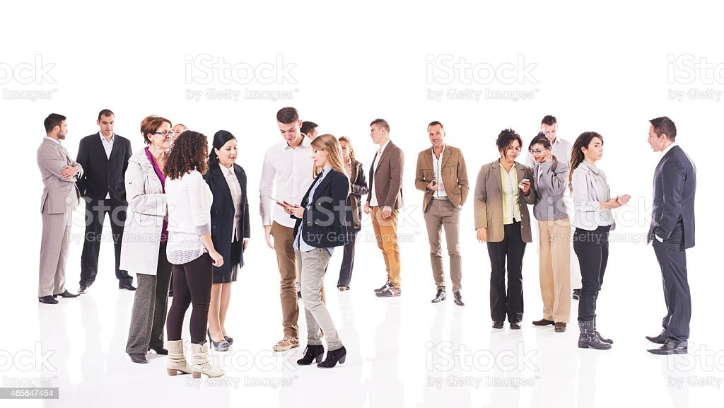 Large group of business people standing and talking. stock photo