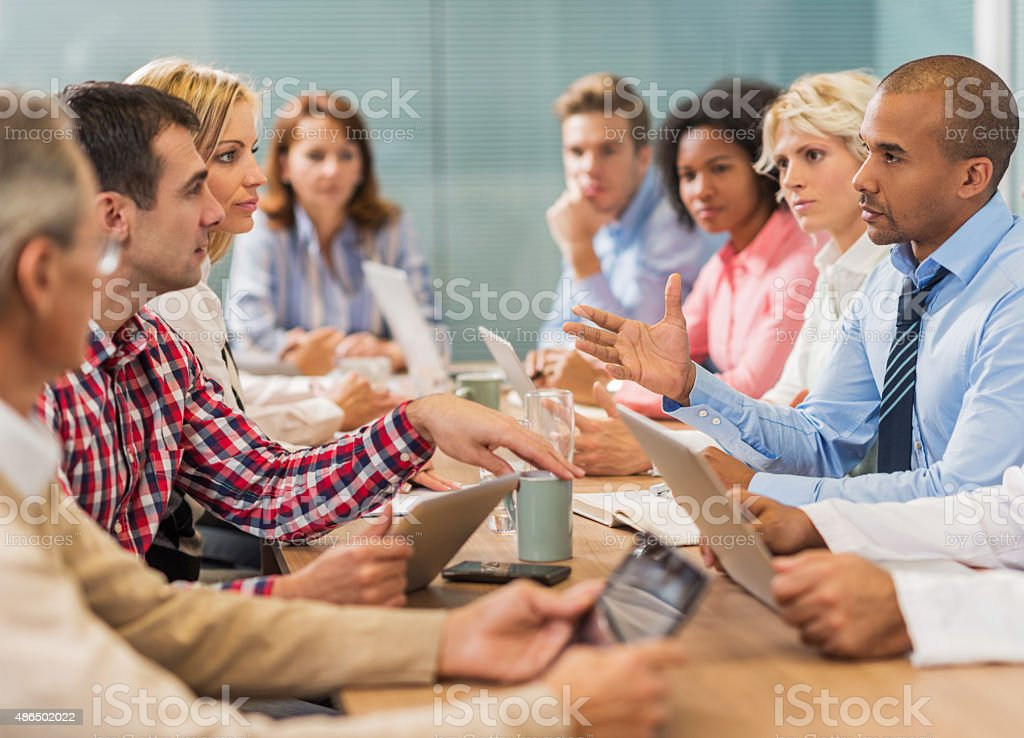 Large group of business people talking on a meeting. stock photo