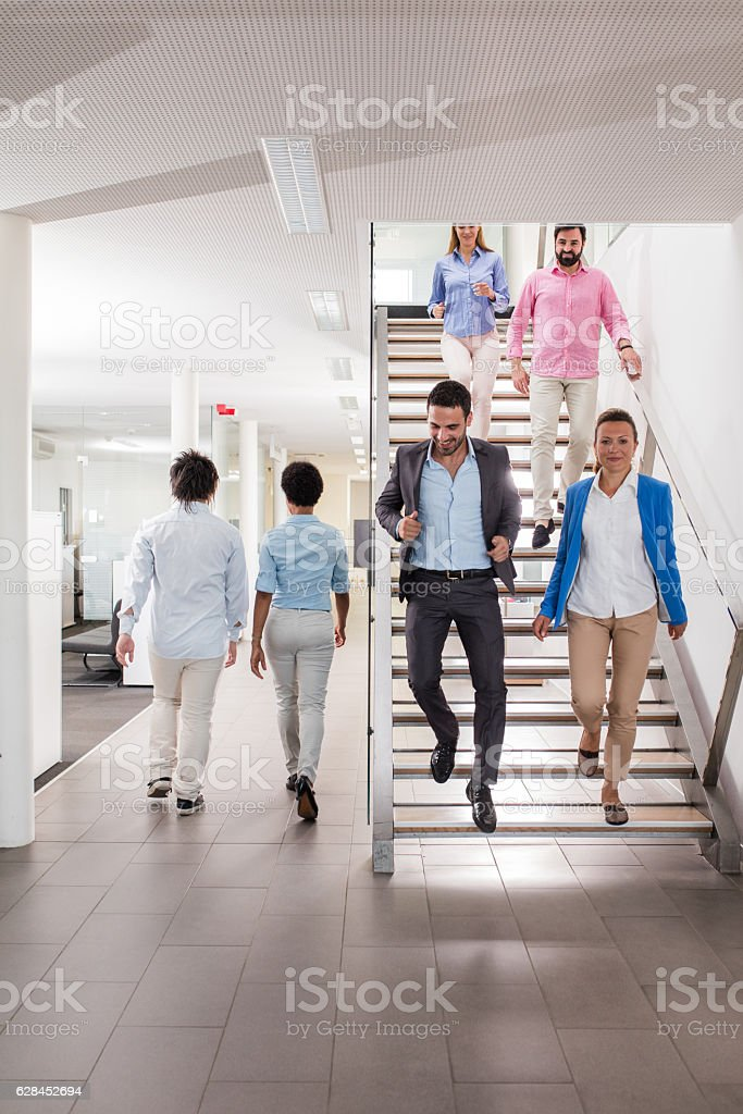 Large group of business people walking in a hallway. stock photo