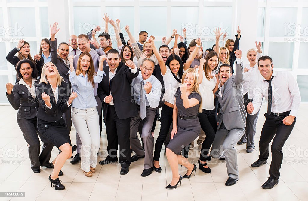 Large group of cheerful business people celebrating. stock photo