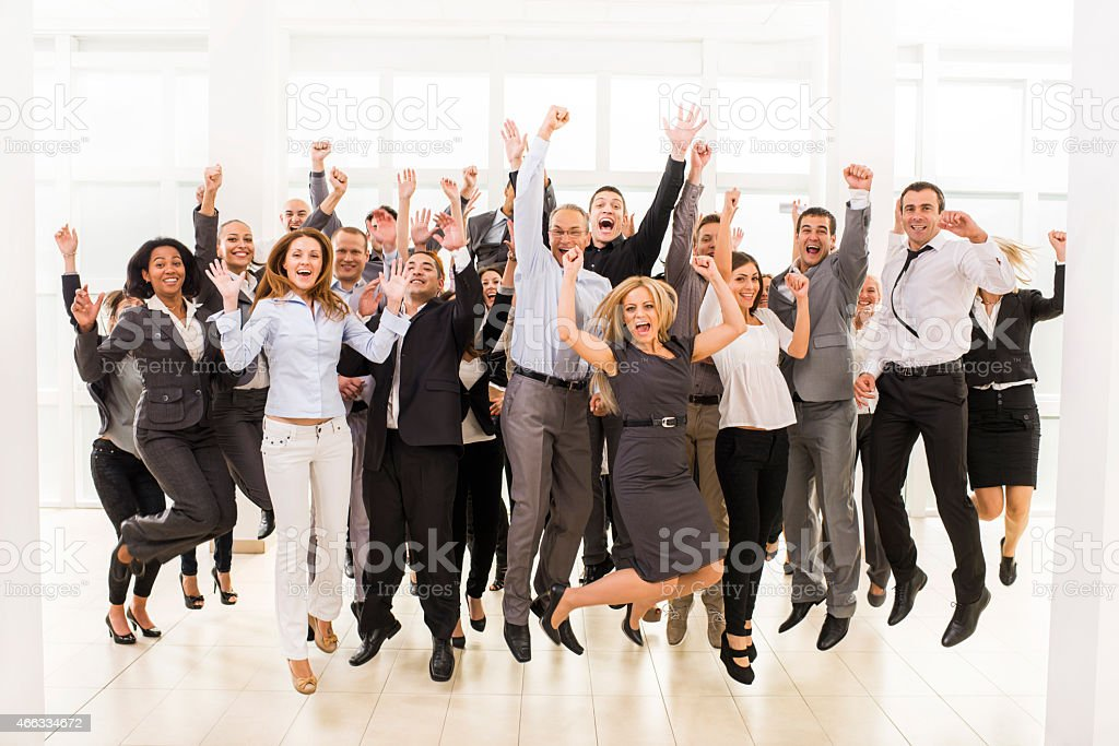Large group of cheerful business people jumping. stock photo