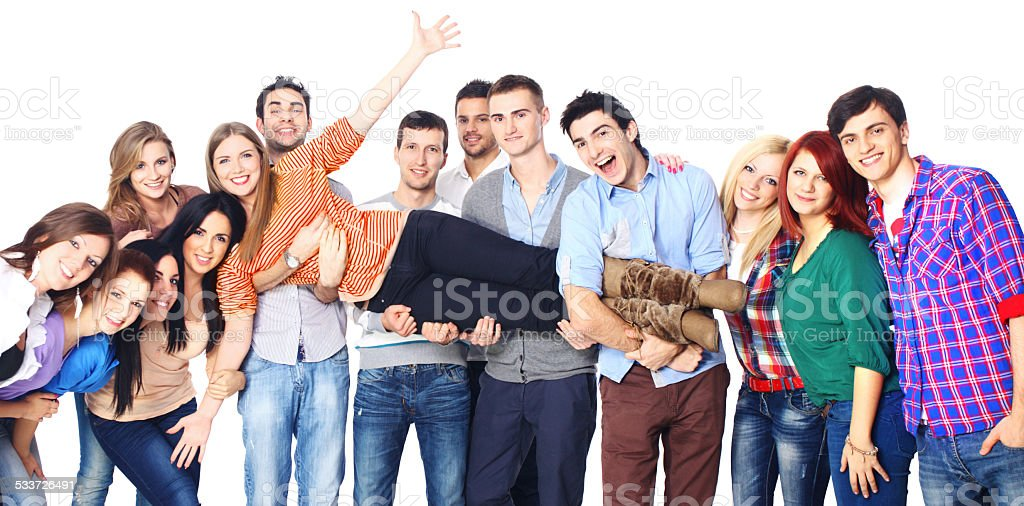 Large group of cheerful young adults. stock photo