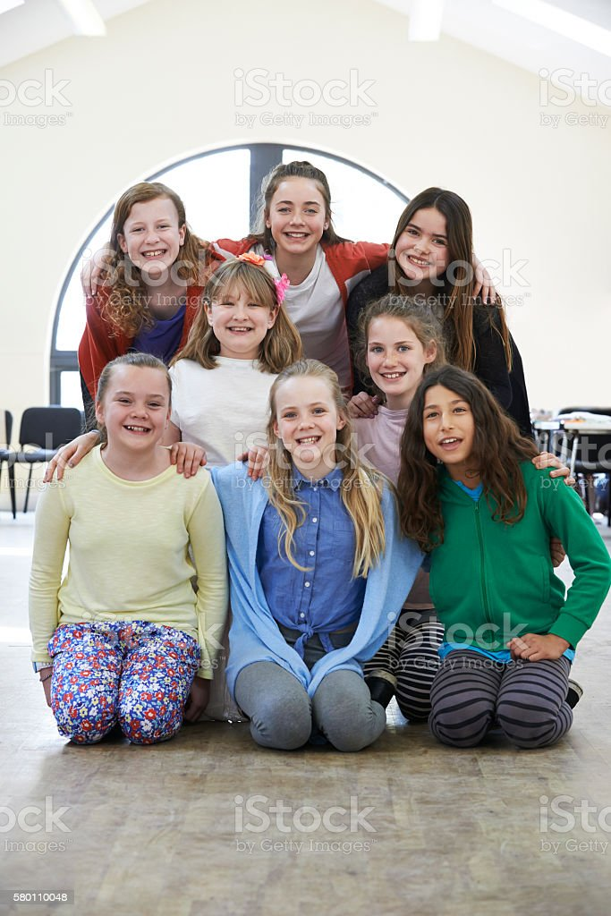 Large Group Of Children Enjoying Drama Workshop Together stock photo