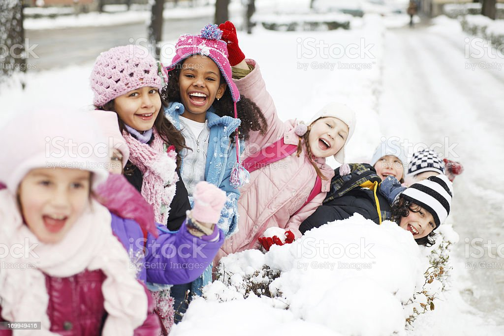 Large group of children having fun in the snow. stock photo