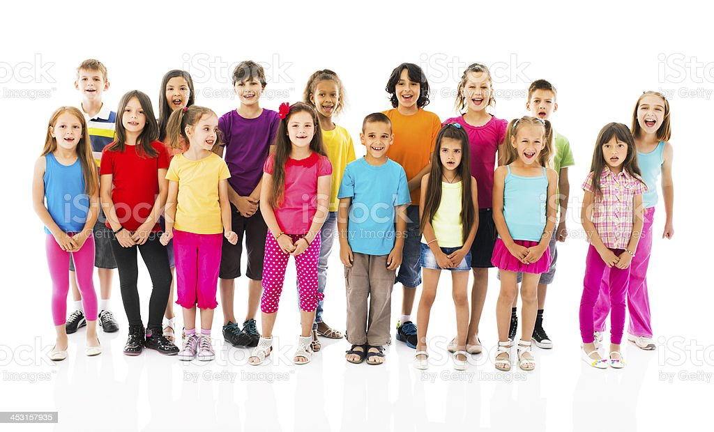 Large group of children singing. stock photo