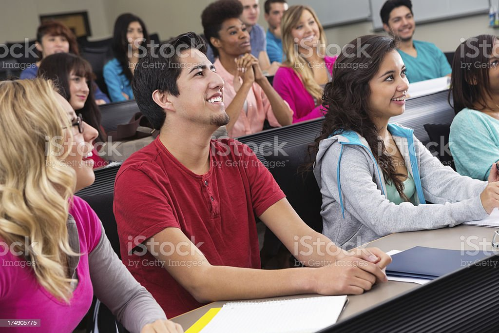 Large group of college students in lecture hall style classroom royalty-free stock photo