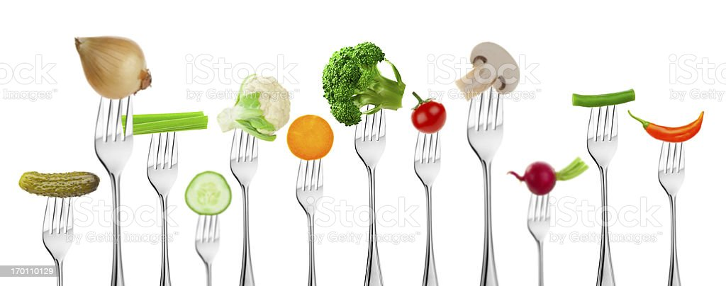 Large group of different vegetables on forks stock photo