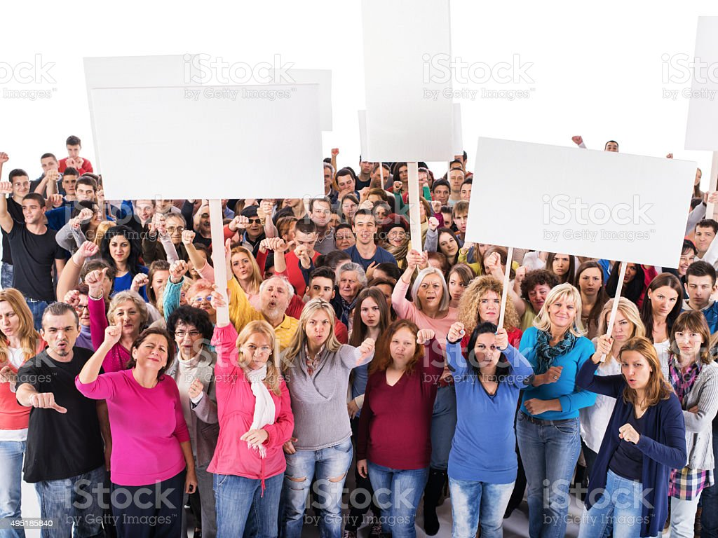 Large group of displeased people holding white banners. stock photo