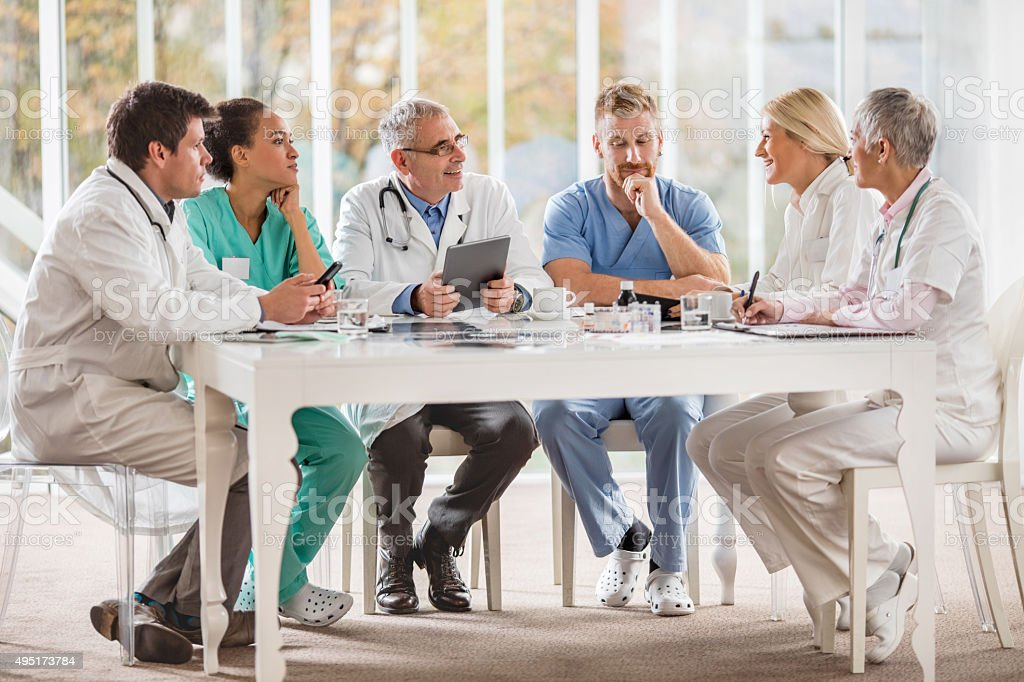 Large group of doctors having a meeting in the hospital. stock photo
