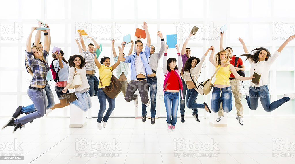 Large group of ecstatic young people. stock photo