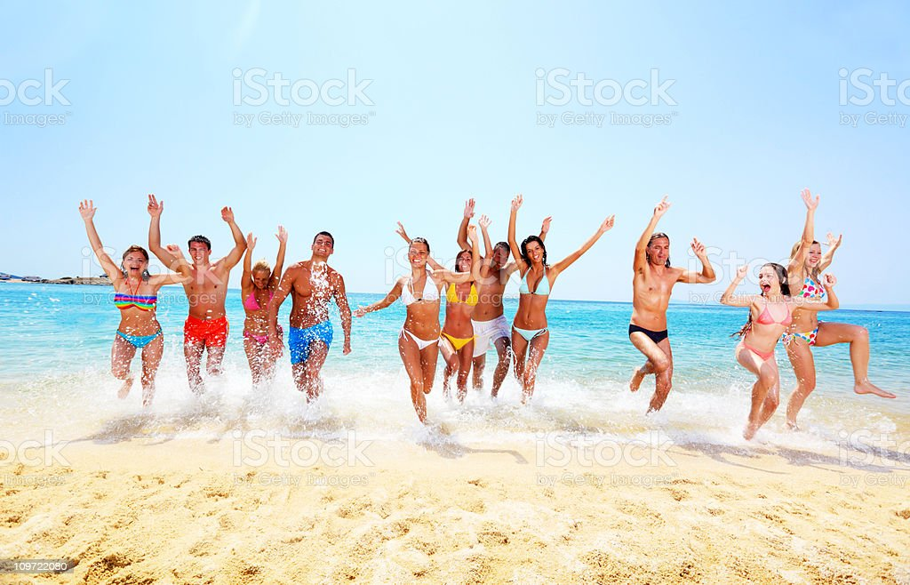 Large group of friends happy run from the sea. royalty-free stock photo