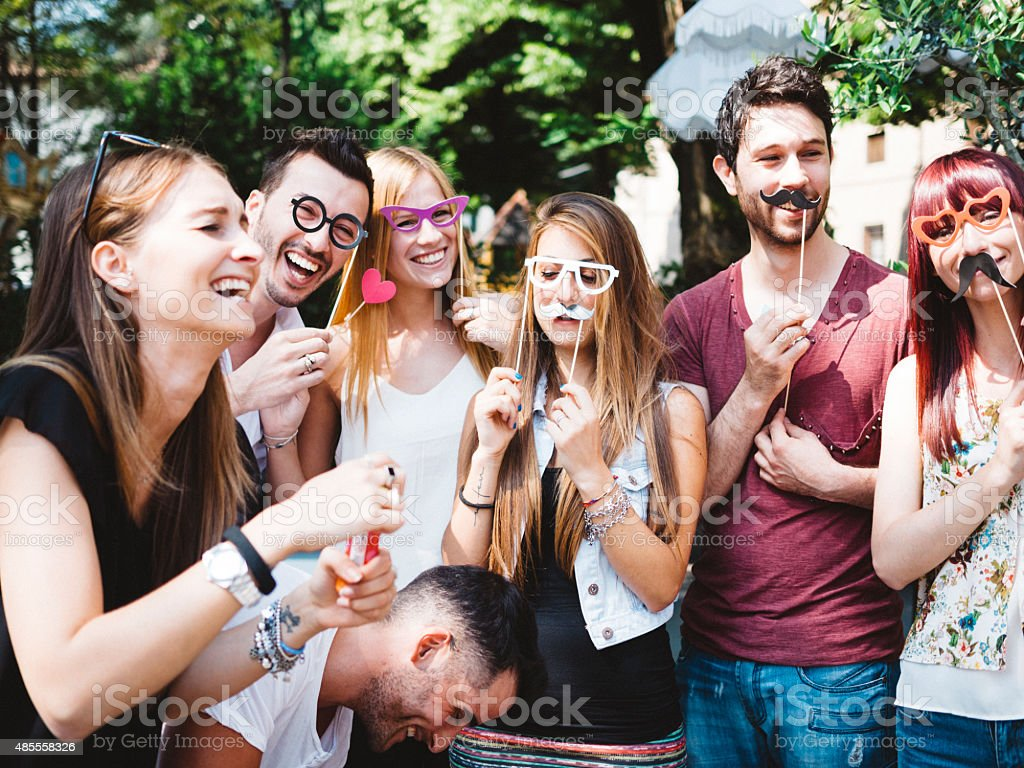 large group of friends making faces stock photo