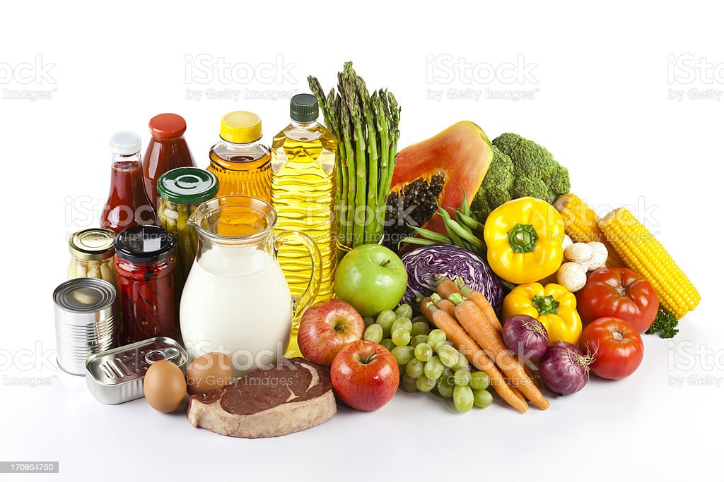 Large group of groceries arranged neatly on white table stock photo