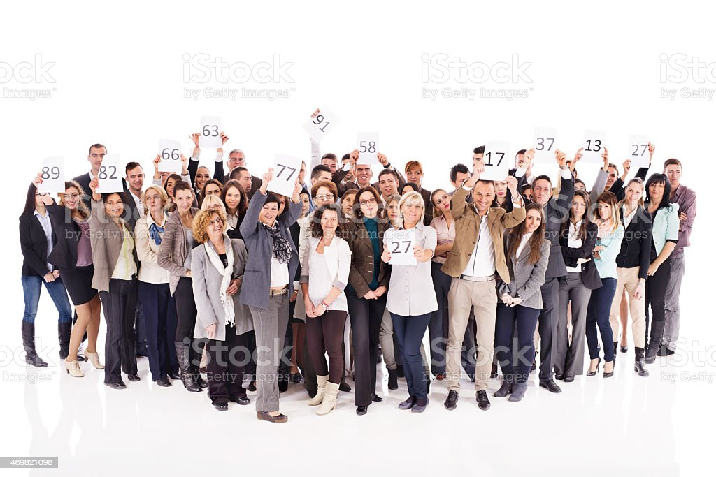 Large group of happy business people on auction. stock photo