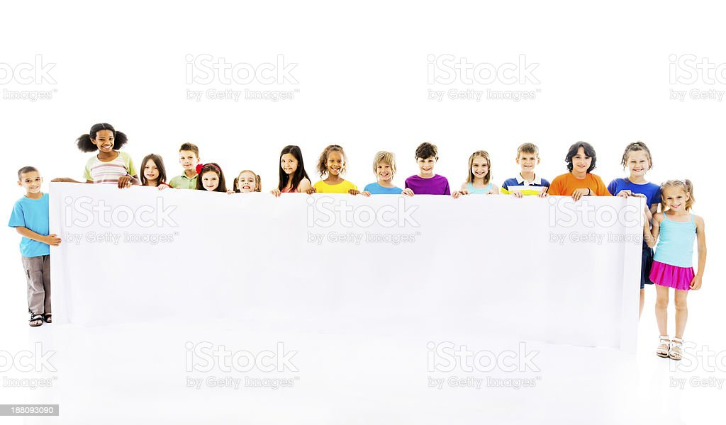 Large group of happy children holding white banner. royalty-free stock photo