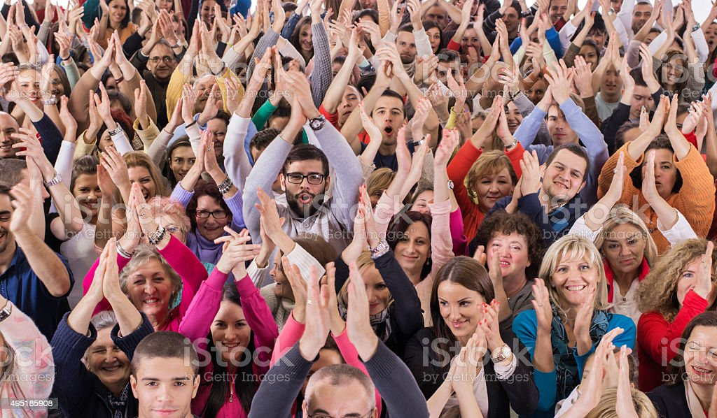 Large group of happy people applauding. stock photo