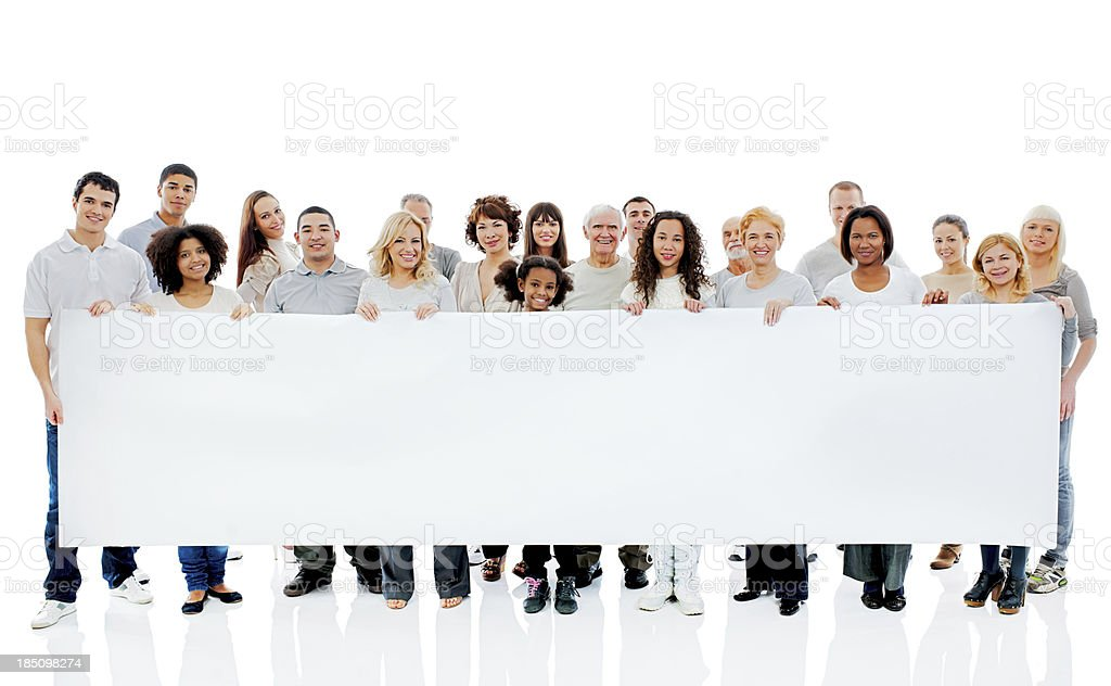 Large group of  happy people holding a big white board. royalty-free stock photo