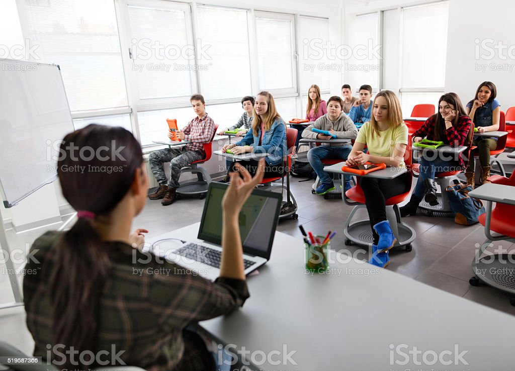 Large group of high school students attending a modern class. stock photo