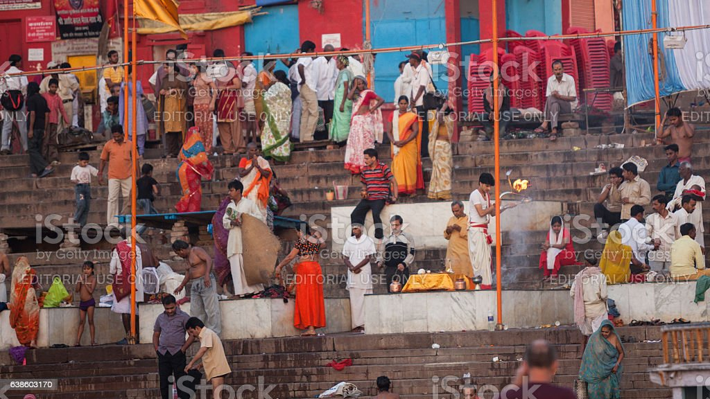 Large Group Of Hindu People Praying By Ganges River stock photo