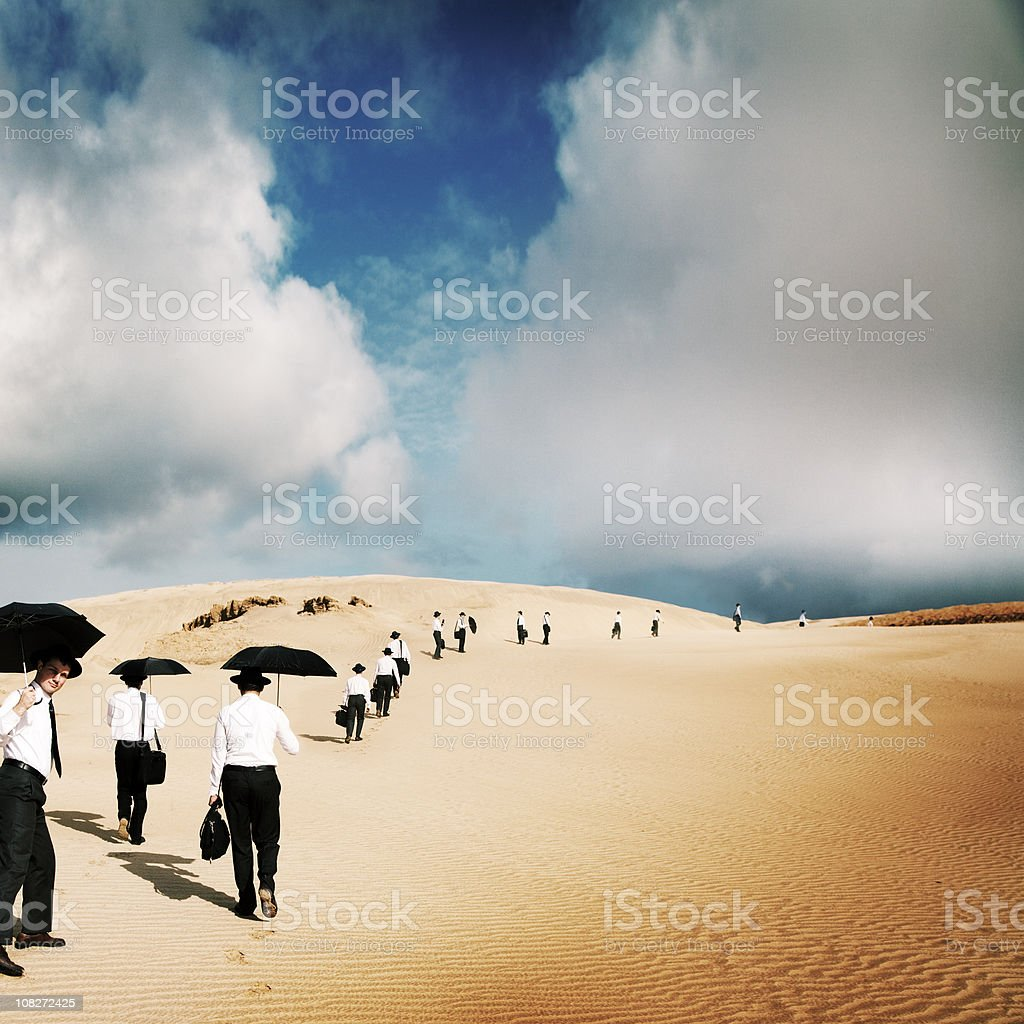 Large group of men travel in desert royalty-free stock photo