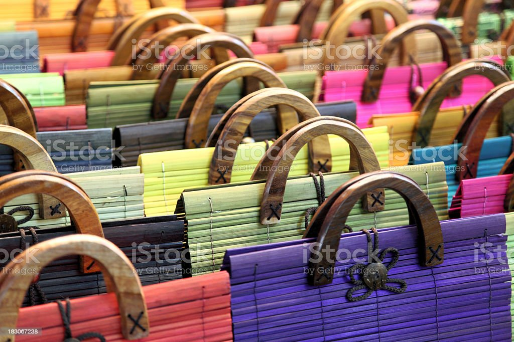 A large group of multi colored purses stock photo