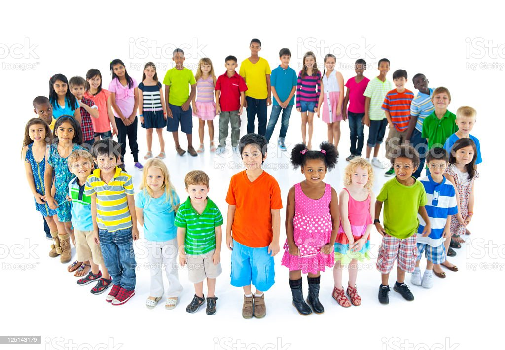 Large group of multi ethnic children standing in a circle royalty-free stock photo