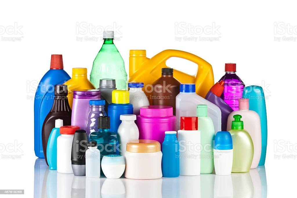 Large group of multicolored plastic bottles against white background stock photo