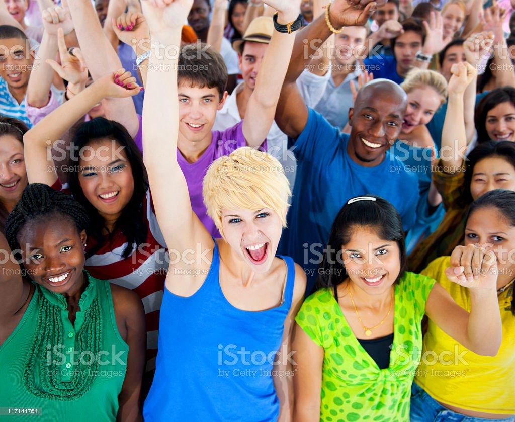 Large group of multi-ethnic young people celebrating royalty-free stock photo