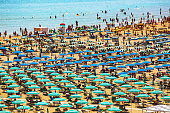 Large group of parasols at the beach of Rimini