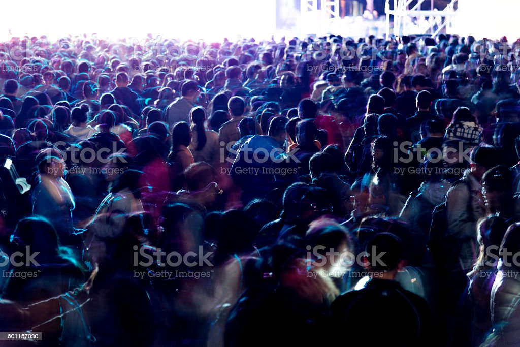 large group of people at concert stock photo