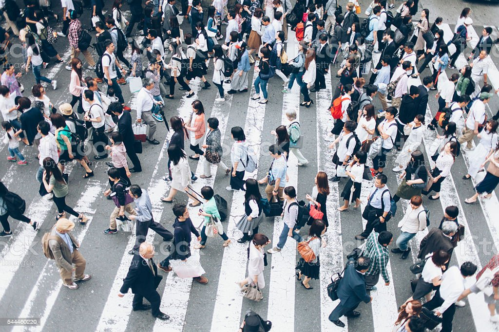 Large group of people crossing the street in Kyoto,Japan stock photo