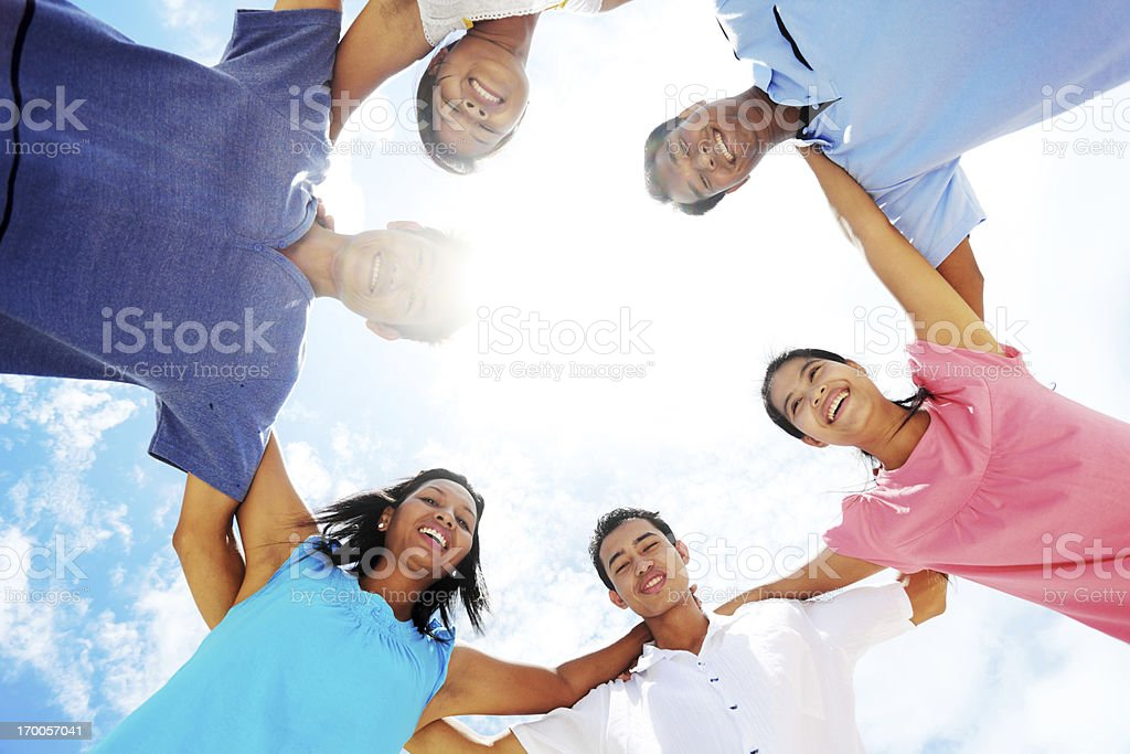 Large group of people embracing and smiling together. royalty-free stock photo