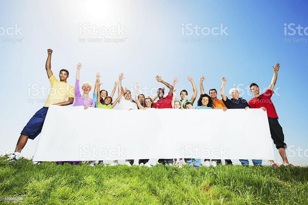 Large group of people holding a big white board. royalty-free stock photo