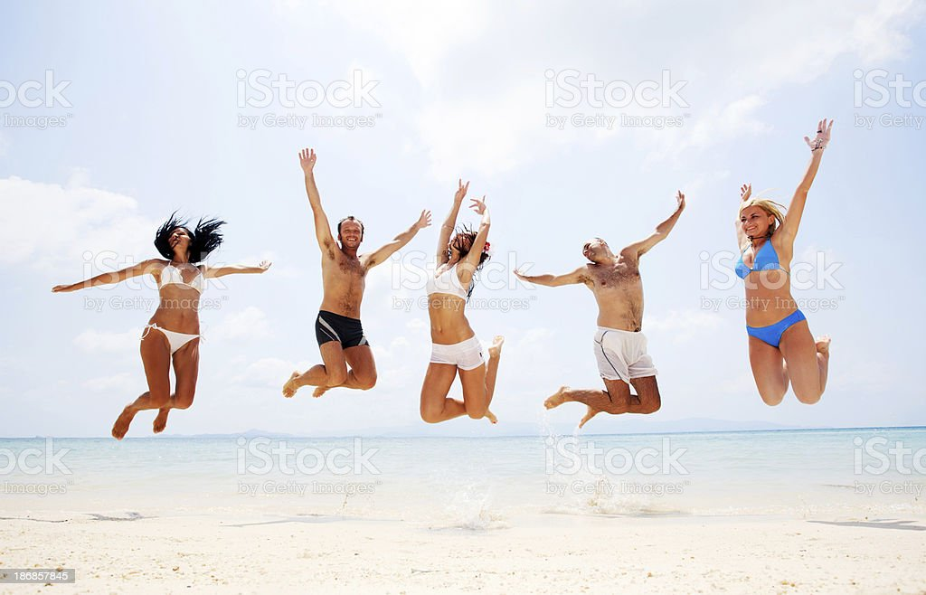 Large group of people jumping on the beach royalty-free stock photo