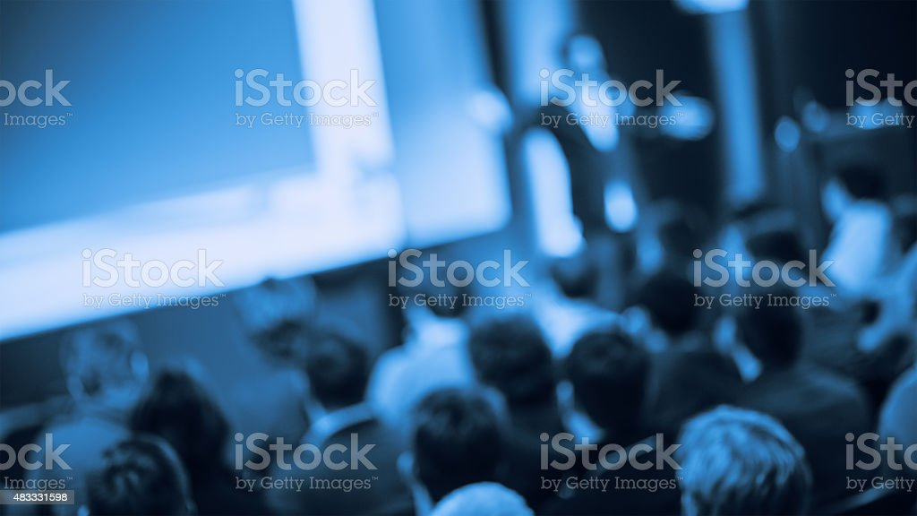 Large Group of People Listening to a Presentation stock photo