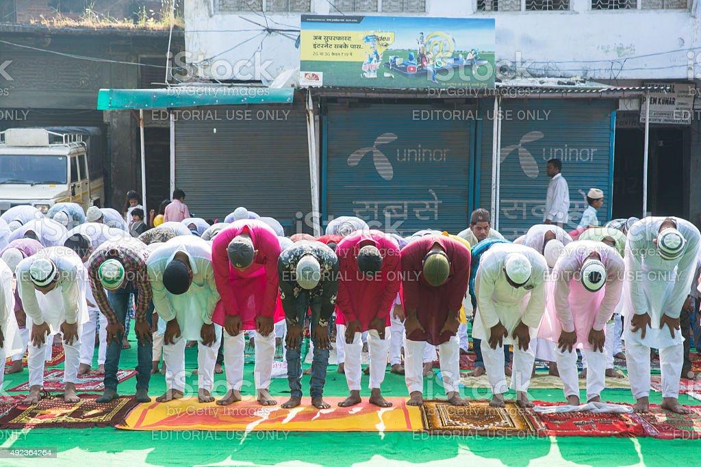 Large group of people praying Namaz on Eil-al-adha stock photo