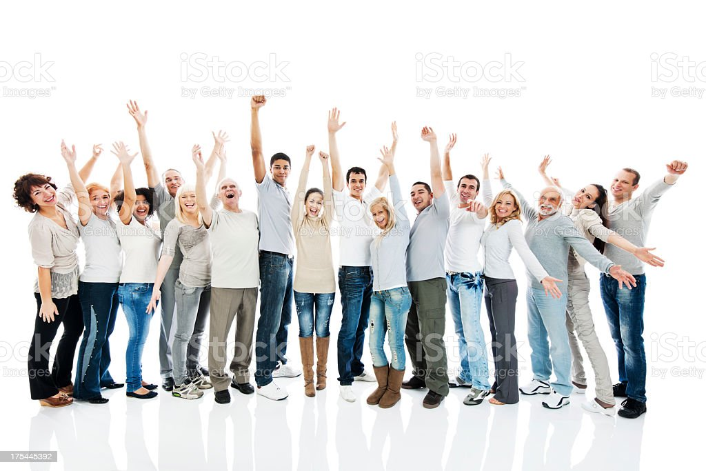 Large group of people standing together with raised arms. stock photo