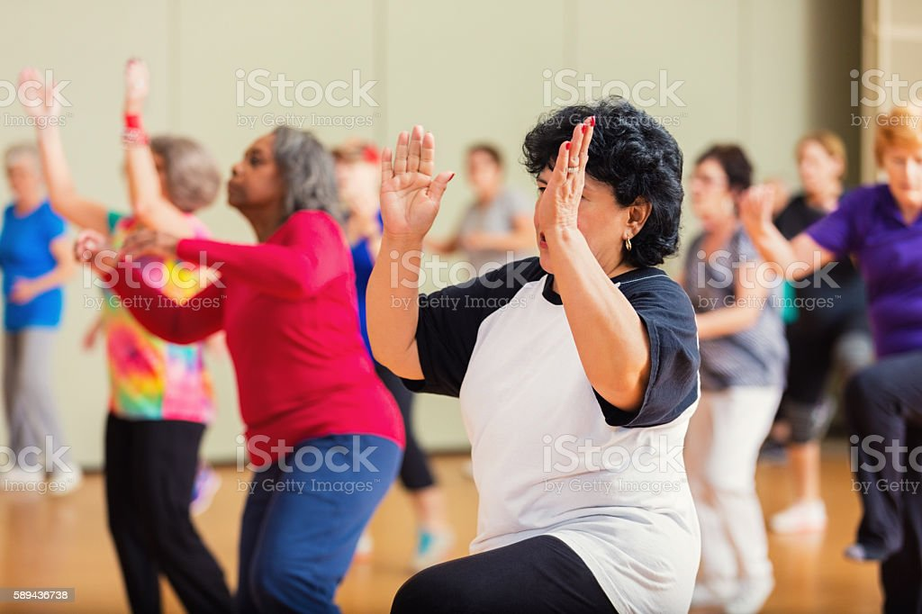 Large group of people take dance lessons stock photo