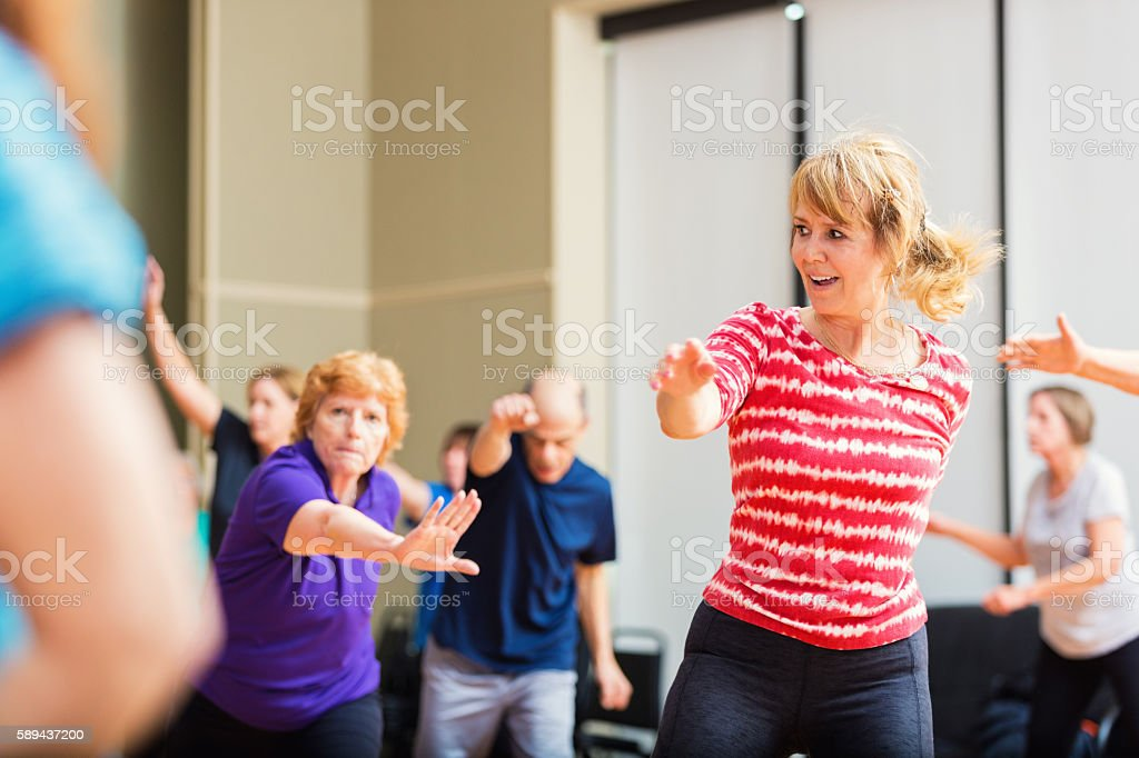 Large group of people taking dancing fitness class stock photo