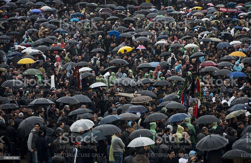 Large group of people under rain stock photo