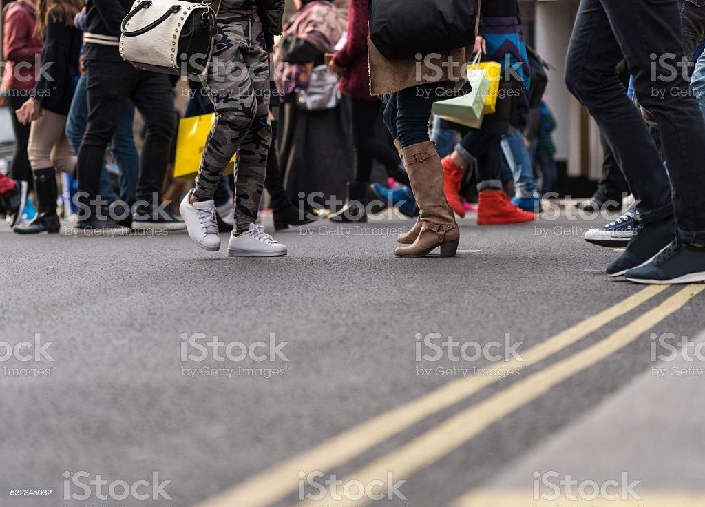 Large group of people walking on walkway stock photo
