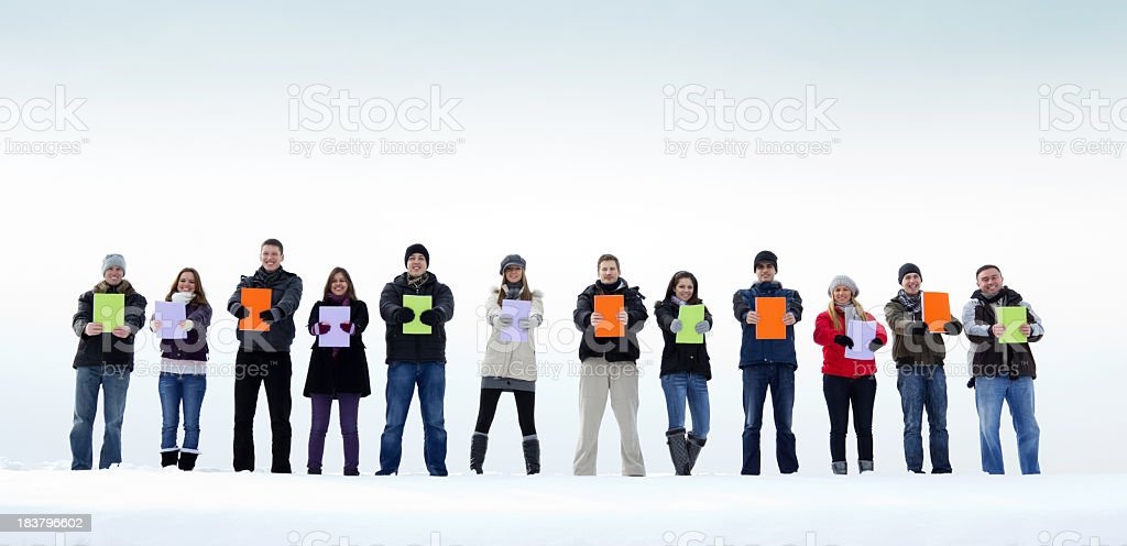Large group of people with books at winter day. royalty-free stock photo