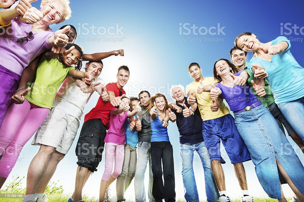 Large group of people with their thumbs up stock photo