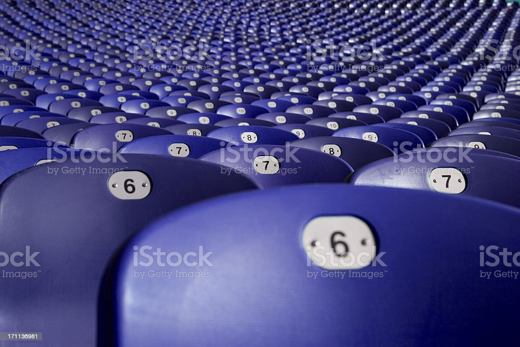 large group of plasitc seats at soccer station in munich royalty-free stock photo