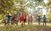 Large group of playful children having fun in the park.