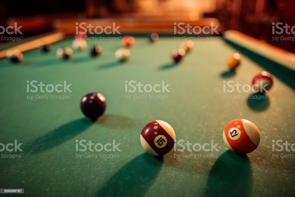 Large group of pool balls on a table. stock photo