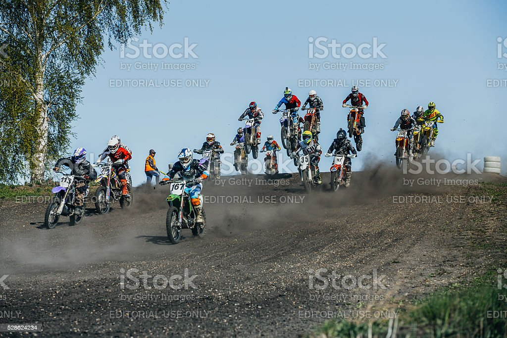large group of riders on motorcycle ride with mountains stock photo