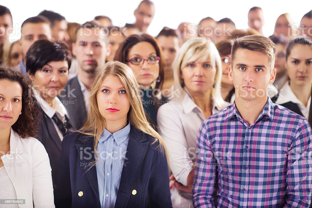 Large group of serious business people looking at the camera. stock photo