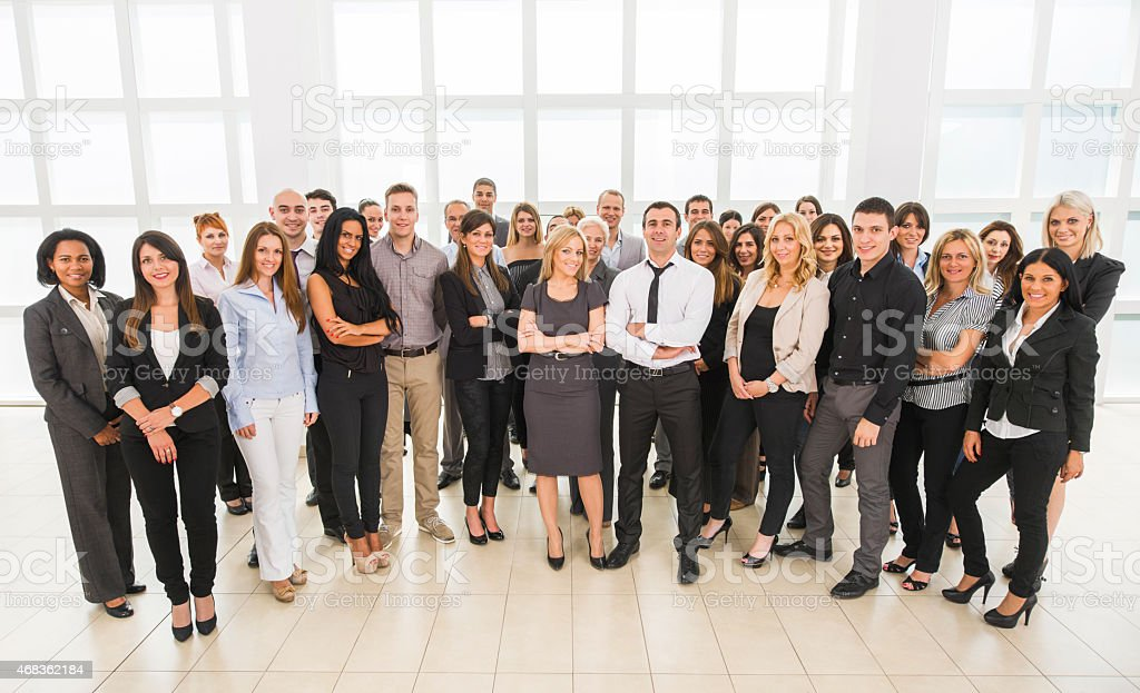 Large group of smiling business people looking at the camera. stock photo