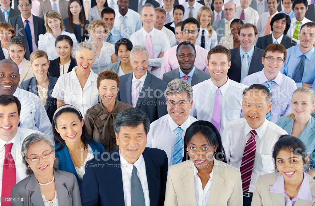 Large group of smiling international business people stock photo